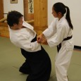 Men can generate a greater degree of power but women tend to catch on to Aikido techniques more rapidly than men.  This is because they can not rely on upper body strength.  They must rely on the generation of power through ki extension.